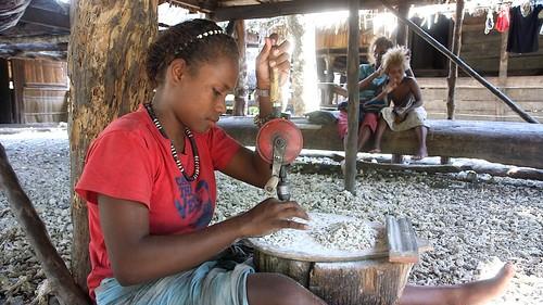 Shell money making, Solomon Islands. Photo by Wade Fairley