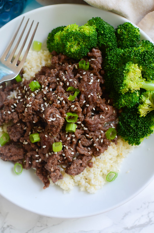 Paleo Korean Beef Bowls - delicious 20 minute meal! Spicy and sweet beef served over cauliflower rice!
