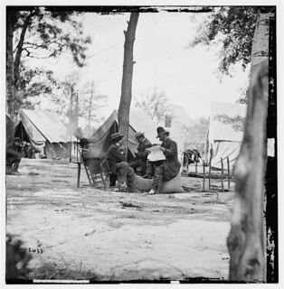 General Ambrose E. Burnside (reading newspaper) with Mathew B. Brady (nearest tree) at Army of the Potomac Headquarters - Newell F. Hill served under Burnside | by serendipitysusan