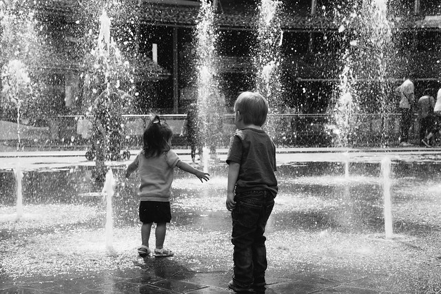 Will and Shiloh playing in fountain-6