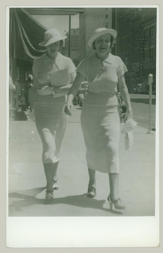 Two women on sidewalk
