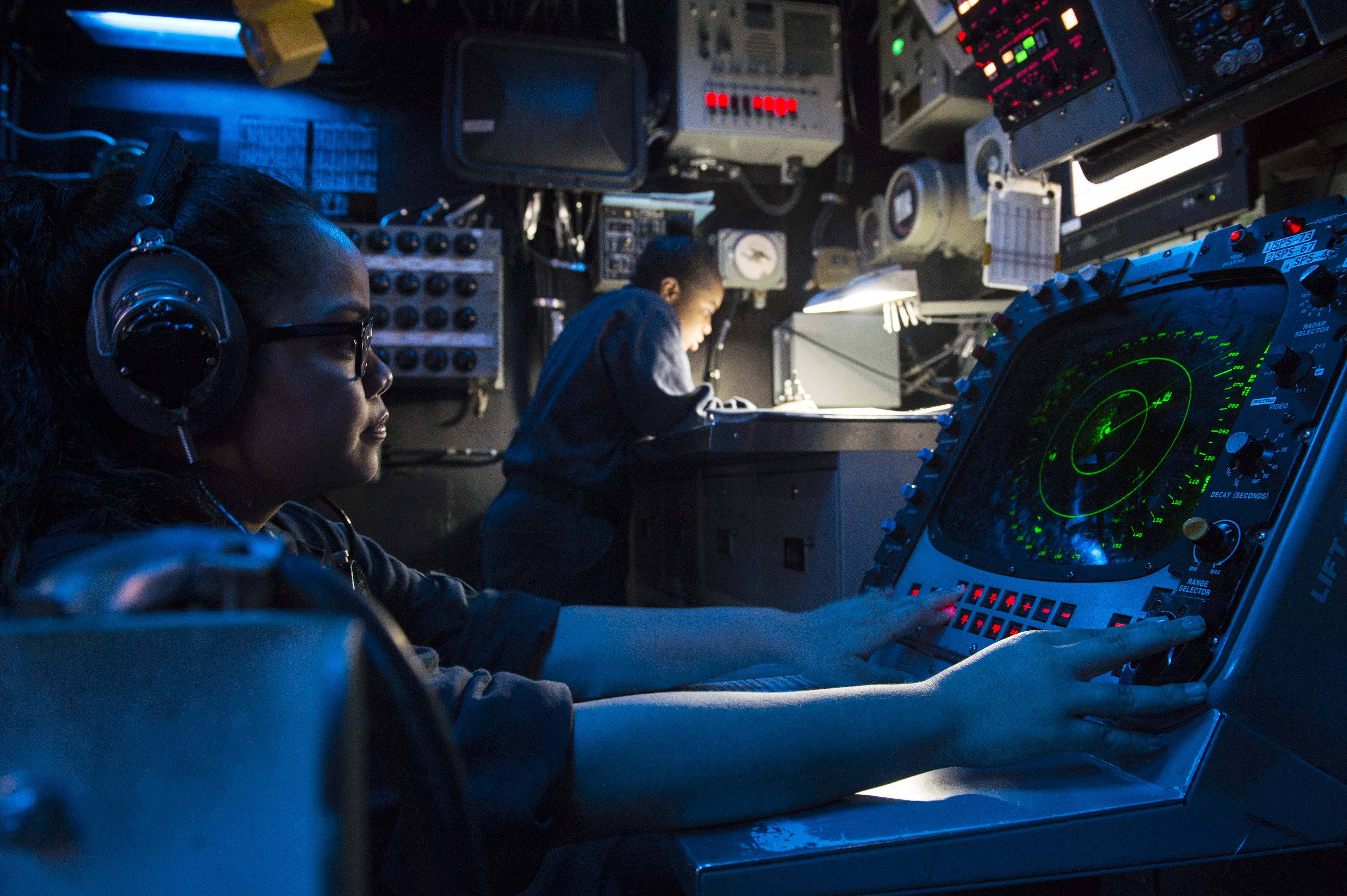 us navy operations specialist 3rd class inside the combat information center cic of the uss harpers ferry lsd 49