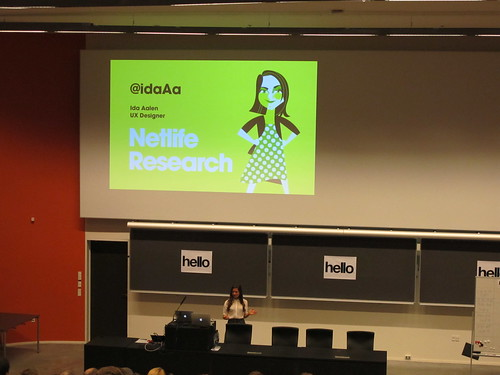 Ida Aalen presenting at UX Camp CPH 2015 with a slide displayed on the large screen behind her