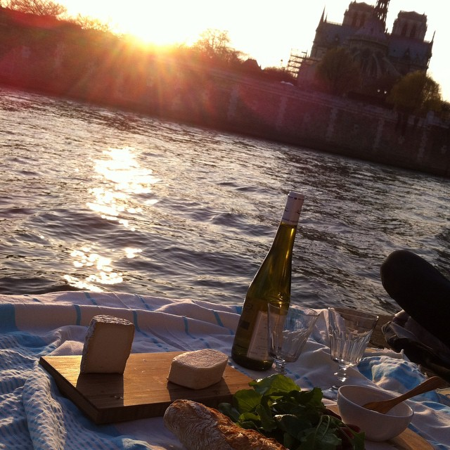 Sunset apéro on the banks of the Seine followed by a delicious dinner and plenty of cheese. #lifeinFrance