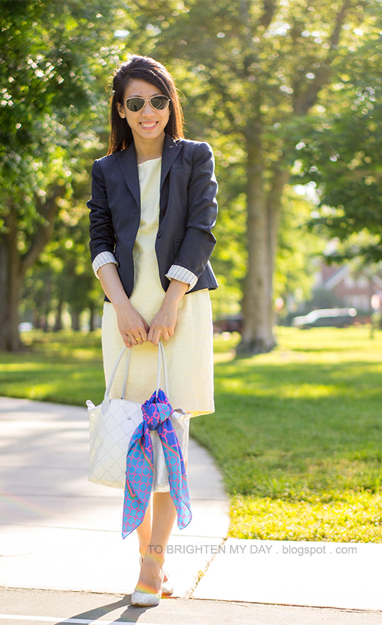 navy blazer, yellow sheath dress, blue chain scarf, white tote bag, snakeskin pumps