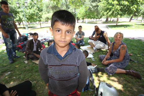 Refugee kid in the park. Taking a break before moving north.