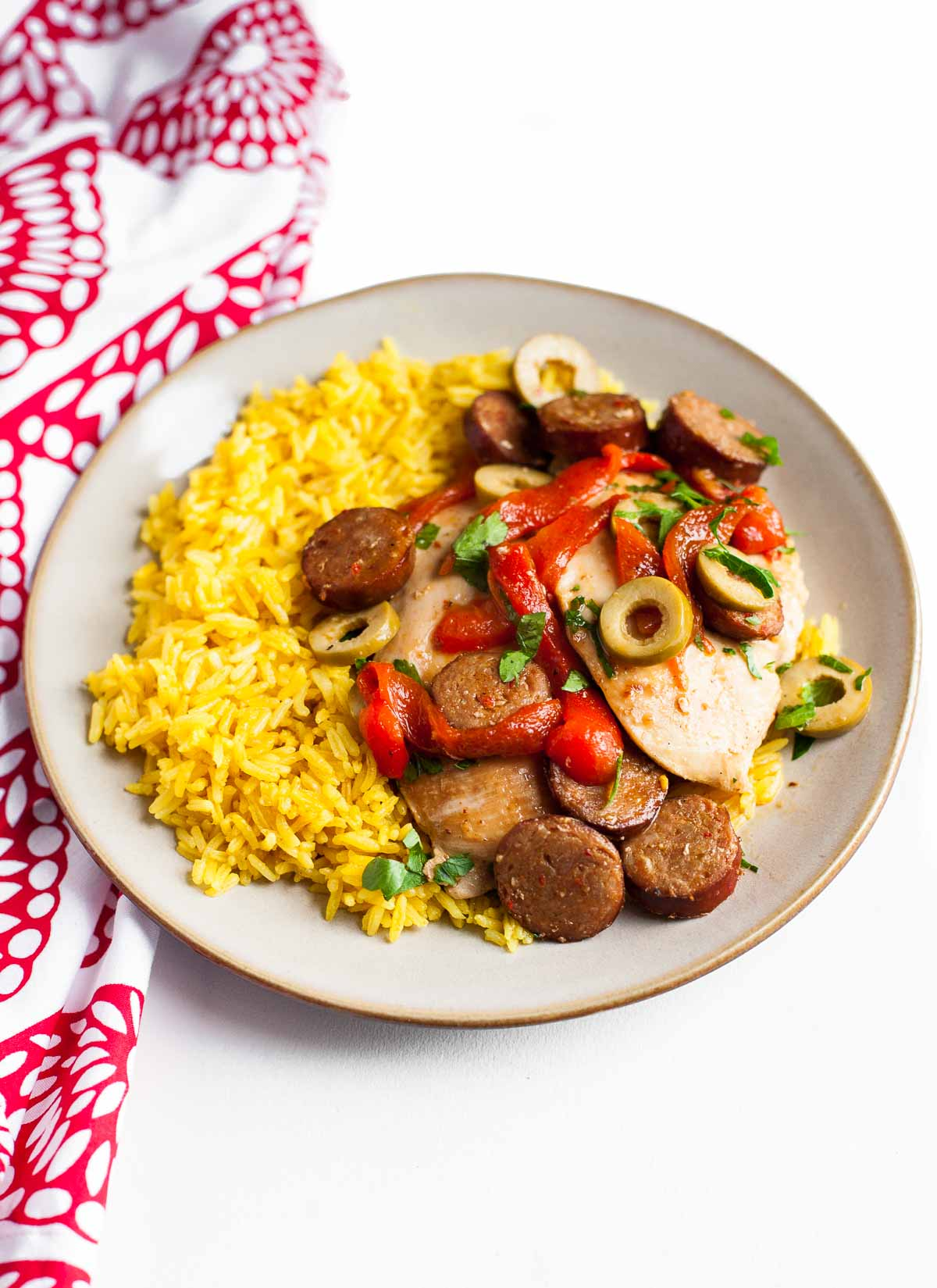 Chorizo Chicken with Olives and Roasted Peppers + Yellow Rice | acalculatedwhisk.com A simple and flavorful paleo dinner!