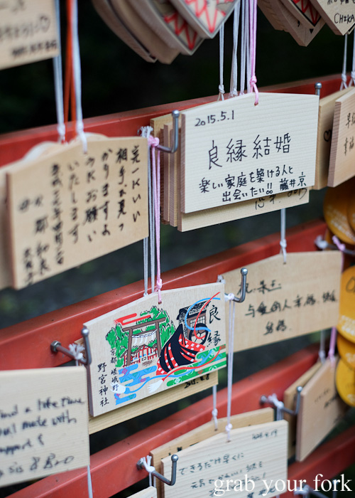 Ema wooden plaques with wishes at Arashiyama Bamboo Grove, Kyoto, Japan