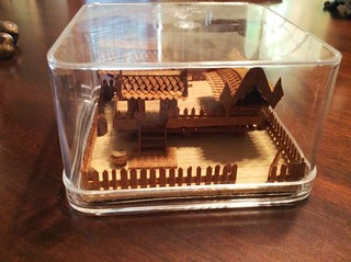 Small carved cork Asian Village | by Thornhill Auction