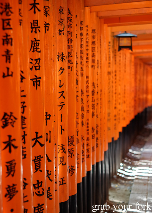 Inscriptions on the gates at Fushimi Inari Shrine, Kyoto, Japan