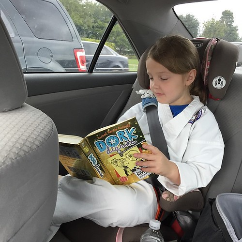 129:365 Saturday morning filled with Karate lessons, speech therapy and a million errands. And this kid squeezes in every second of reading time that she can.