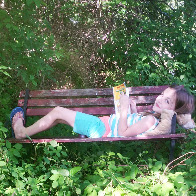 "Instead of throwing away our worn bench, we created a ""Secret Garden"" reading spot for the kids. Lexie grabbed her pillow, iced tea, and book and made herself comfortable! #letthembelittle #playmatters"