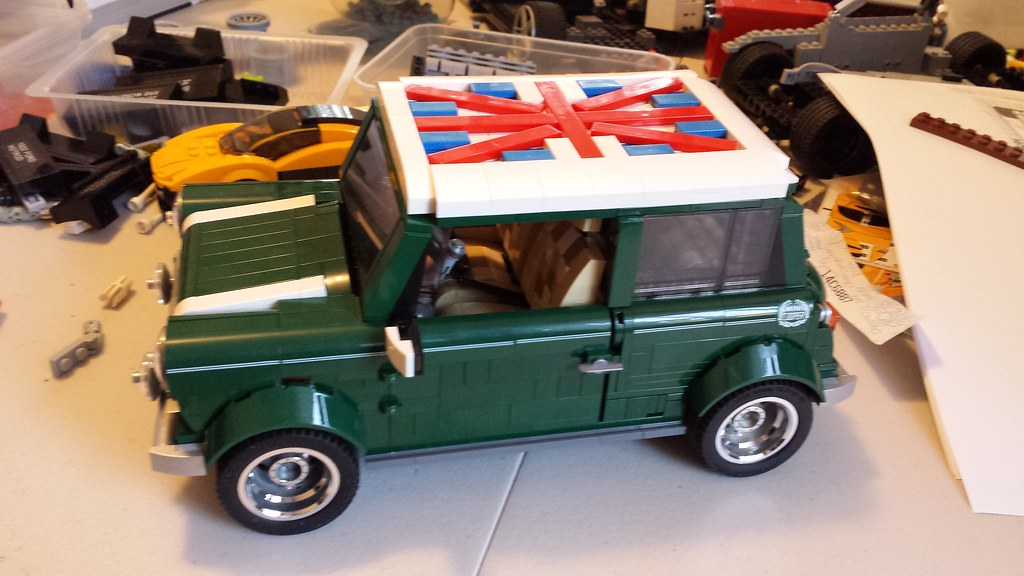 mini cooper i added chrome rims and a union jack roof. Black Bedroom Furniture Sets. Home Design Ideas
