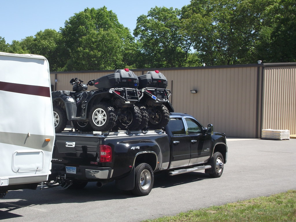 A Chevy Gmc Hauling Atvs And Pulling A Camper Trailer Flickr