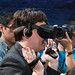 Palmer Luckey (Founder, Oculus) wearing Oculus Rift consumer version and lifting hands to show underside of Oculus Touch prototypes (Half Moon) at Step into the Rift
