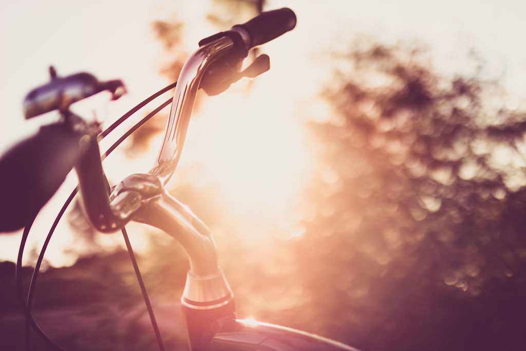 Curved bicycle handlebar at sunset light
