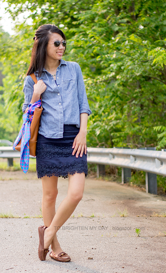 chambray shirt, green jeweled necklace, navy lace mini skirt, brown loafers