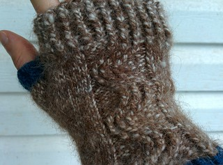 Fingerless mittens I made for myself with a wave-like cable pattern down the middle