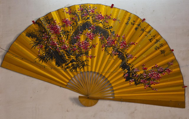 Chinese hand fan in Tong On Church in Tiretta Bazar, Kolkata, India