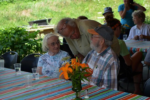 McCabe chats with participants at one of the farm's community lunch events complete with homemade soup, bread, dessert, and great conversation.
