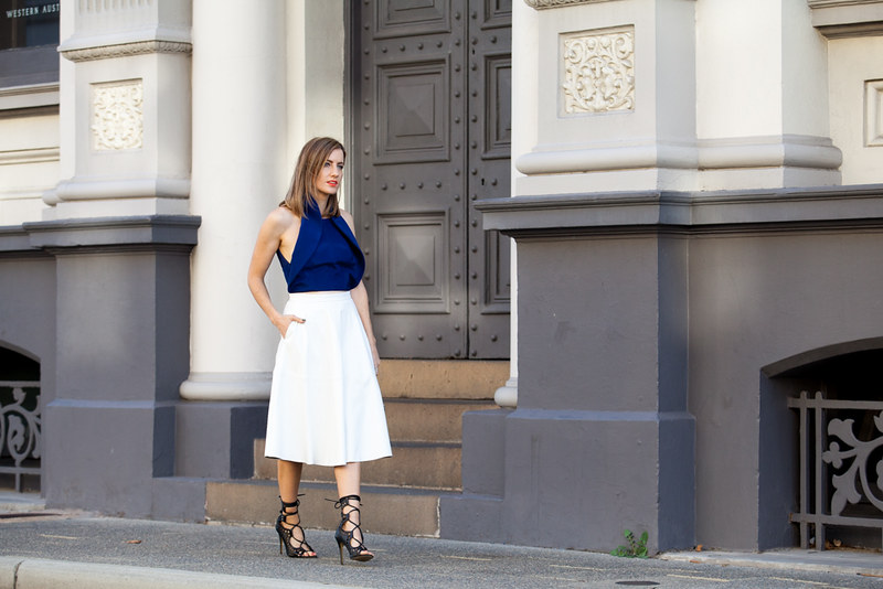 Wearing white midi skirt, Windsor Smith Gillie heels
