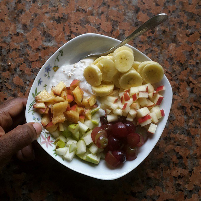 Breakfast. The morning after. Natural yogurt with oats mixed in. Fruit. Peaches. Pear. Red grapes, sliced. Apple - Pink Lady, sweet & crisp. Bananas, sliced. Listening to Isabel Allende's TED2007 'Tales of Passion'. 'What I fear most is power with imp