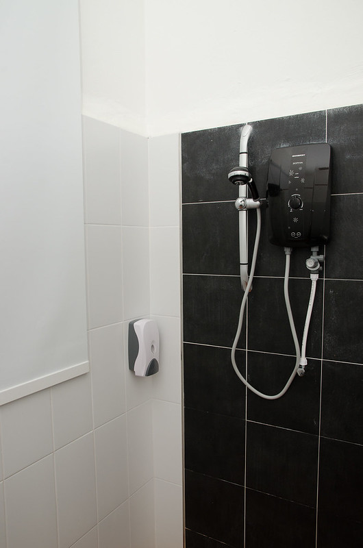 Hot water shower in bathroom at Havara Place Homestay
