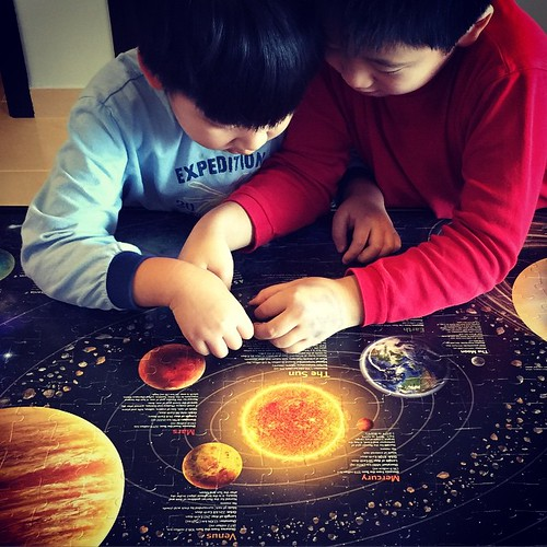 Lazy mornings with the boys... Mum does all the hard work and the boys put in the finishing touches... #solarsystem #jigsaw #puzzles