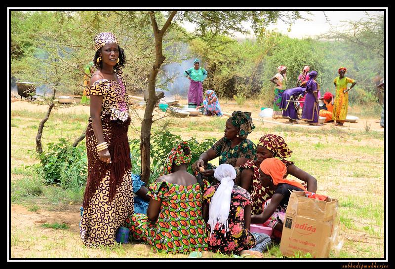 Women Preparing Feast Marking End of Harvest