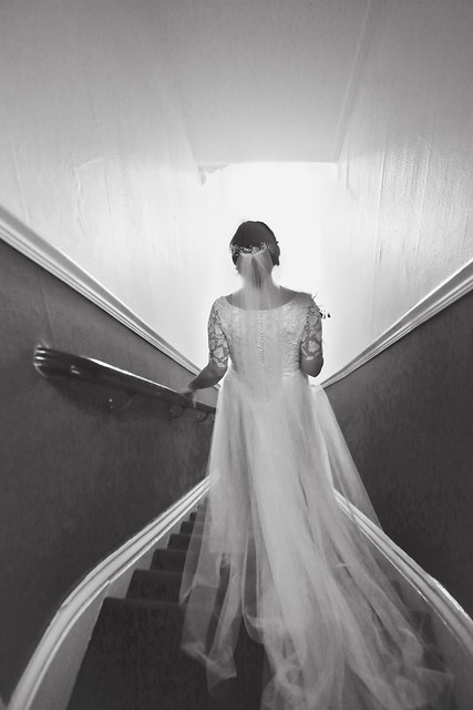 bride walking down the stairs, long tulle train and chapel length veil