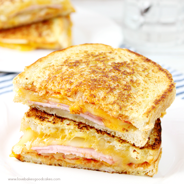 Hawaiian Pizza Grilled Cheese Sandwich stacked up on a plate.