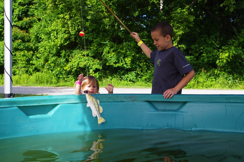 Brother Catches A Fish For His Sister From The Toddler Tank At 2014 Kids Fishing Derby