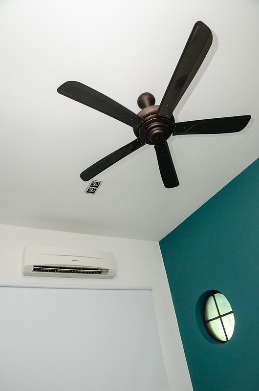Bedroom with ceiling fan in Havara Place Homestay, Penang