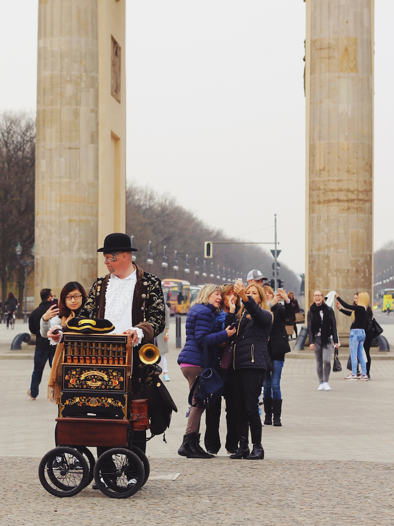 Berlin Brandenburger Tor tattooed organ grinder