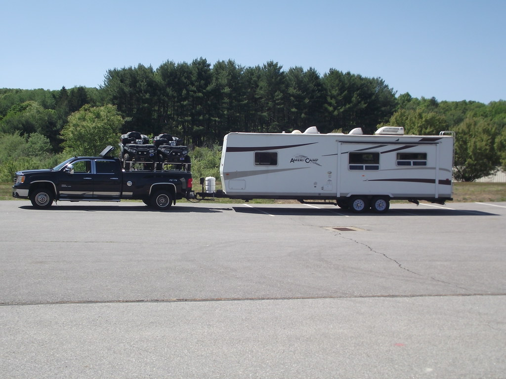 New Gmc Truck >> A Chevy/GMC Hauling ATVs and Pulling A Camper Trailer | Flickr