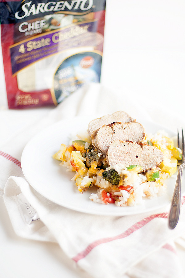grilled pork tenderloin with cheesy baked rice and vegetables