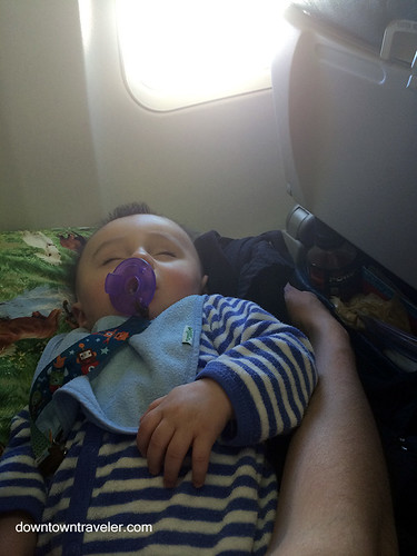 Sleeping baby on a plane | by Downtown Traveler