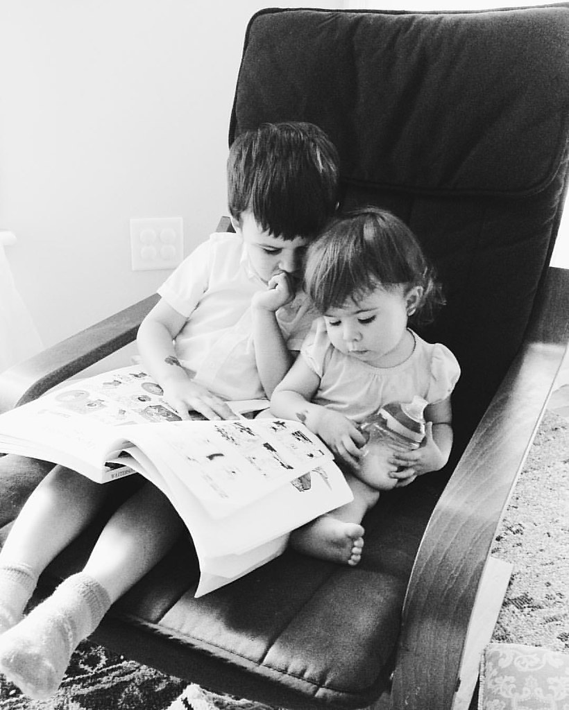 Reading Calvin and Hobbes. #instasinclair #instaluther #siblings #childhood #calvinandhobbes