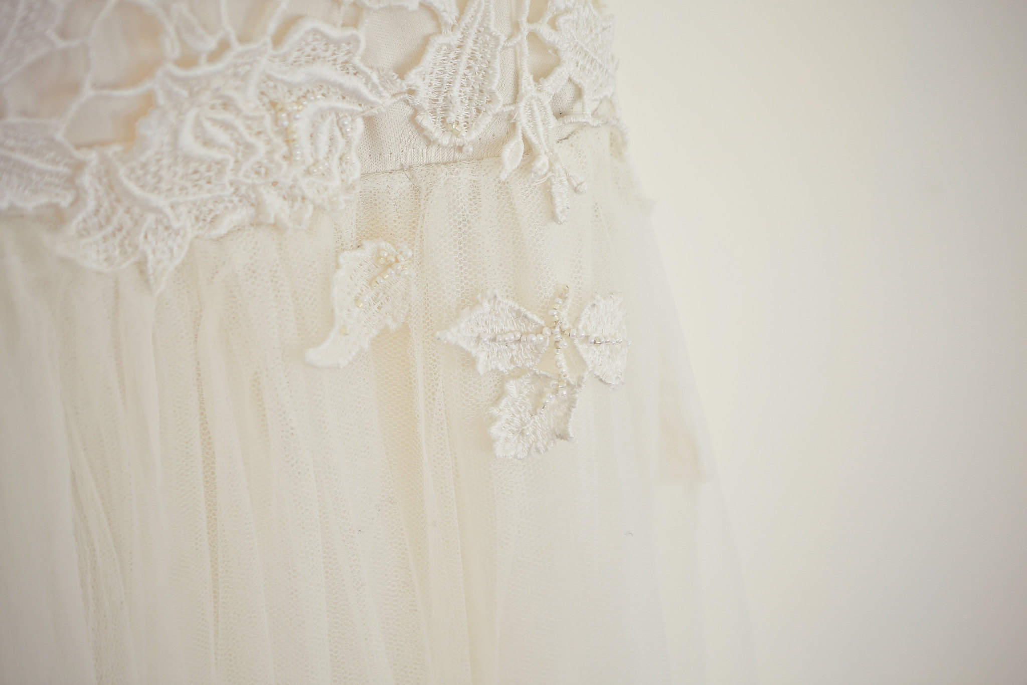 delicate beading on a lace and tulle wedding dress