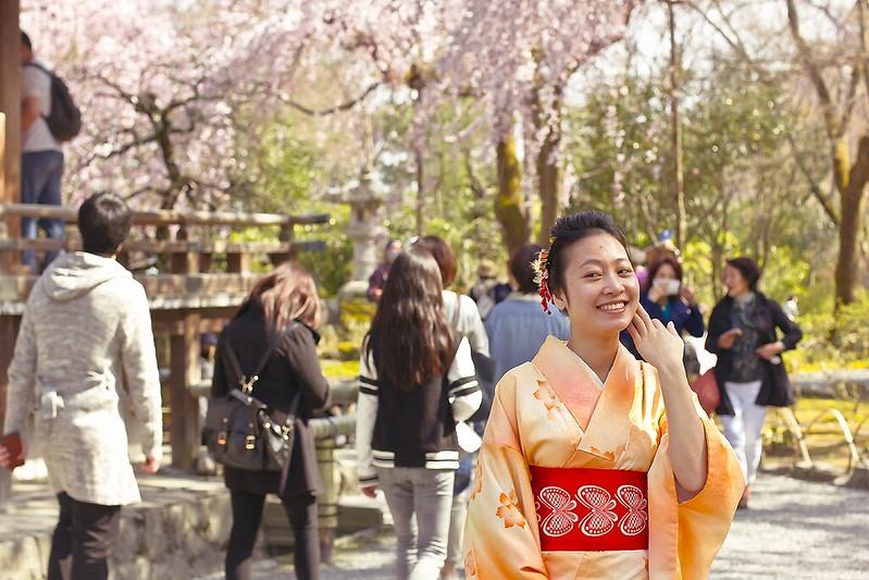 Laila outside girl in black dress sakura flower blossom hanami kyoto japan