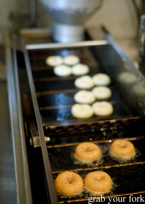 Soy milk doughnuts in the deep fryer at Konnyamonja at Nishiki Market, Kyoto