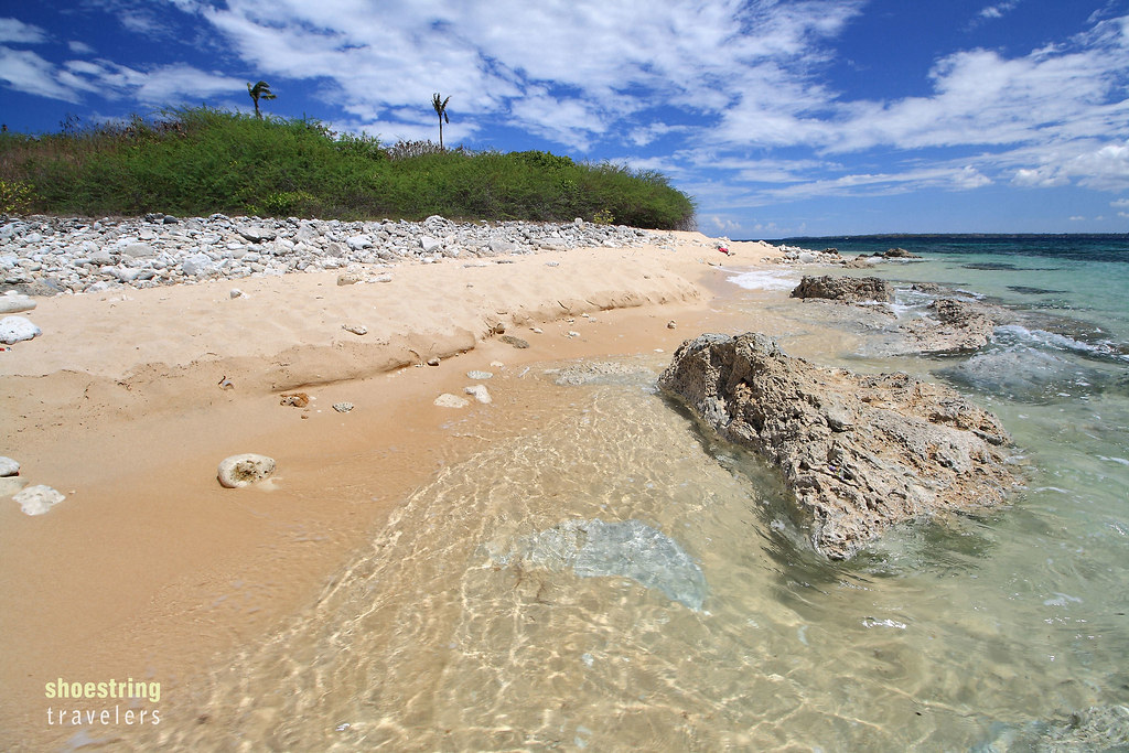 creamy white sand and coral rocks at Colibra Island, Dasol, Pangasinan