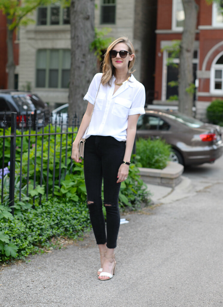 classic white equipment short sleeve blouse with ripped black jeans