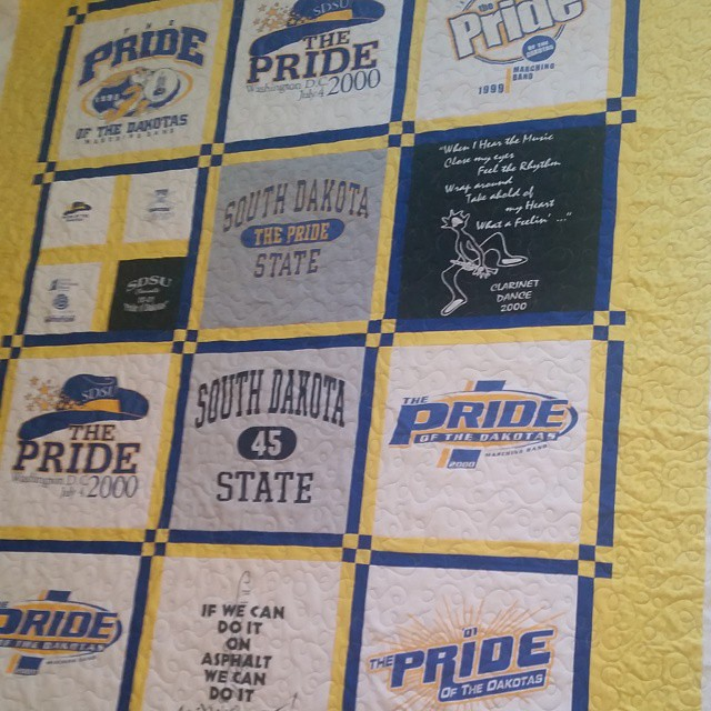 Quilted my SDSU Pride of the Dakotas t-shirt quilt today at dad and Ann's. It was so fun using a blue and yellow verigated thread and quilting loops. I am so happy to be close to a finish with this kbe. I started it two weeks ago and with any luck will ha
