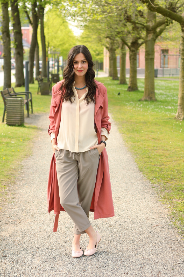 outfit: pink duster coat, silk blouse, loose trousers and ballet flats