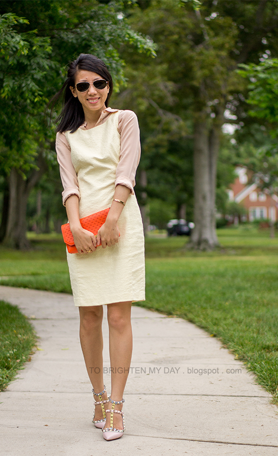 peach silk shirt, pale yellow dress, orange clutch, watercolor studded flats