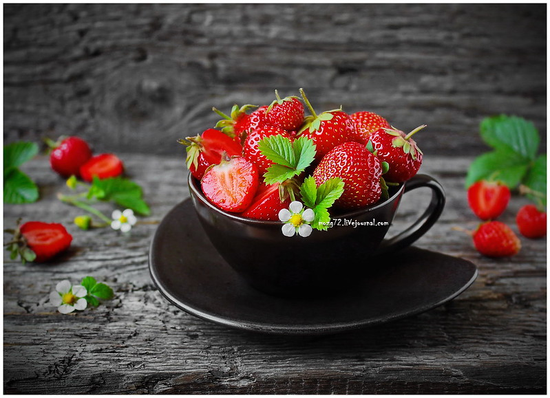 ...strawberries on black dish