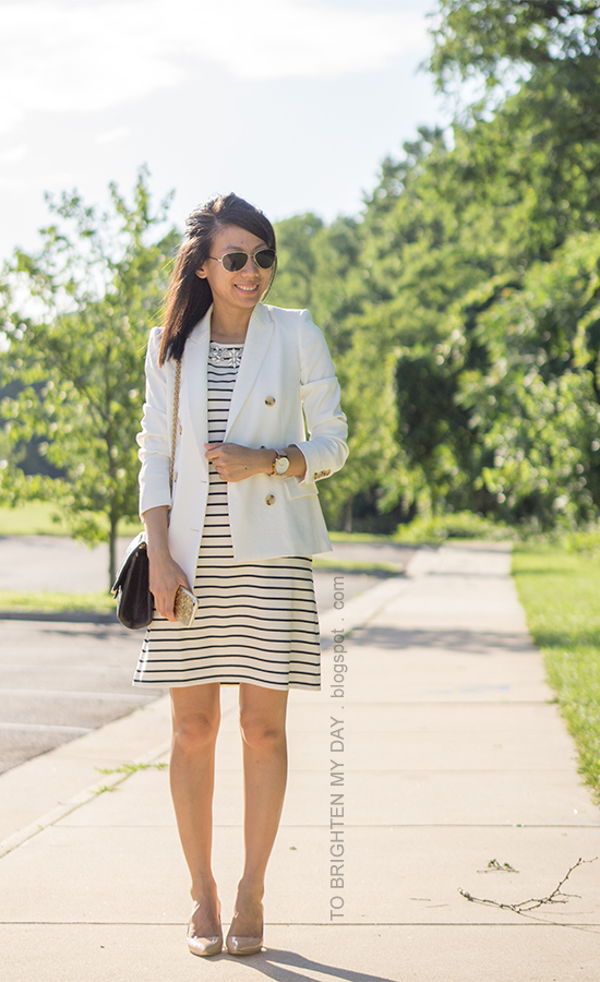 white blazer, jeweled shift striped dress, oversized watch, black shoulder bag, nude pumps